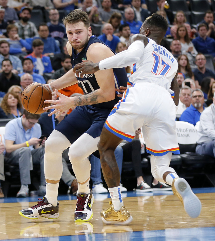 Photo - Dallas' Luka Doncic (77) drives against Oklahoma City's Dennis Schroder (17) in the third quarter during an NBA basketball game between the Oklahoma City Thunder and Dallas Mavericks at Chesapeake Energy Arena in Oklahoma City, Monday, Jan. 27, 2020. Dallas won 107-97. [Nate Billings/The Oklahoman]
