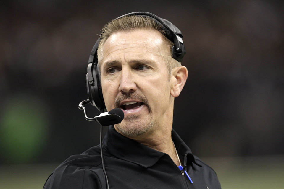 In this Sept. 9, 2012, photo, New Orleans Saints defensive coordinator Steve Spagnuolo watches during the first half of the Saints\' NFL football game against the Washington Redskins in New Orleans. The Baltimore Ravens hired former Saints defensive coordinator Spagnuolo as a senior defensive assistant on Friday, May 3, 2013, offering Spagnuolo an opportunity at redemption following an unsettled 2012 season in which he oversaw a historically bad defense with scandal-plagued New Orleans. (AP Photo/Matthew Hinton)