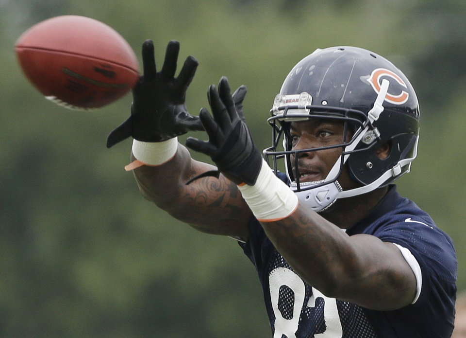 Chicago Bears tight end Martellus Bennett (83) catches a ball during NFL football training camp Saturday, July 27, 2013, at Olivet Nazarene University in Bourbonnais, Ill. (AP Photo/Nam Y. Huh)