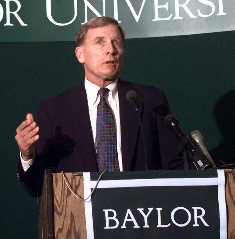 Photo - Dave Bliss speaks during a press conference Tuesday, March 23, 1999 in Waco, Texas after he was named the new men's head basketball coach at Baylor. Bliss spent his last 11 seasons at New Mexico. (AP Photo/Waco Tribune Herald, Kelly Lemons)