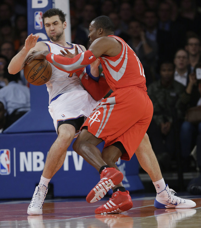 New York Knicks' Andrea Bargnani, left, of Italy, defends Houston Rockets' Dwight Howard (12) during the first half of an NBA basketball game Thursday, Nov. 14, 2013, in New York. Bargnani was called for a foul on the play. (AP Photo/Frank Franklin II)