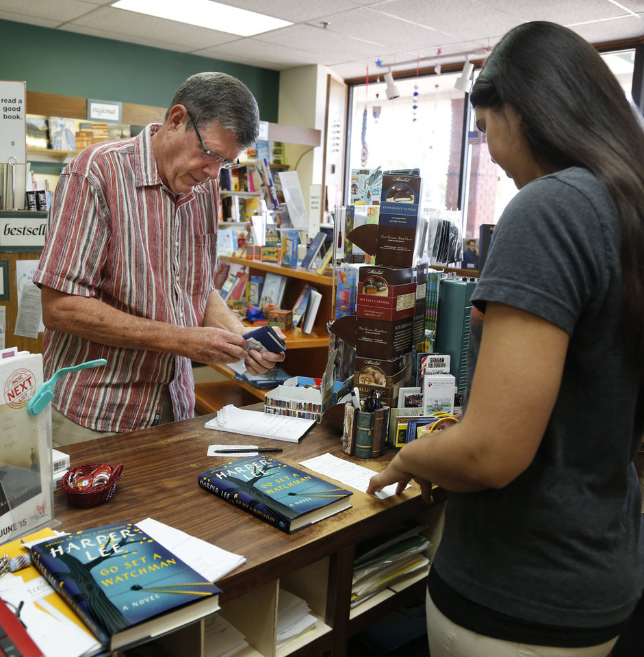 Photo -  Customer Jim Hulsey purchases Harper Lee's new book,