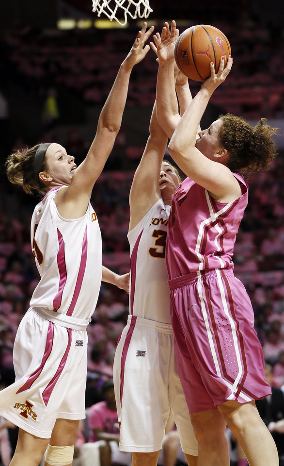Photo - Oklahoma's Joanna McFarland (53) tries to get the ball past Iowa State's Hallie Christofferson (5), left, and Chelsea Poppens (33) during an NCAA women's basketball game between the University of Oklahoma (OU) and Iowa State at the Lloyd Noble Center in Norman, Okla., Thursday, Feb. 14, 2013. Photo by Nate Billings, The Oklahoman
