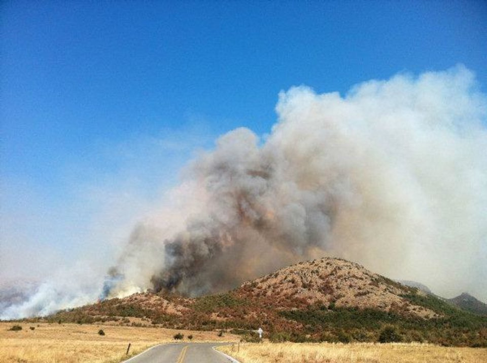 Photo - Homes were destroyed in a fire that continued to rage Friday in the Wichita Mountains Wildlife Refuge and Comanche County near Meers.  Provided - American Red Cross of Central Ok