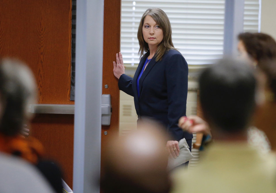 Photo -  Tulsa Police Officer Betty Shelby enters the courtroom for her manslaughter trial in the shooting of Terence Crutcher May 15, 2017. [Photo by Mike Simons, Tulsa World File]
