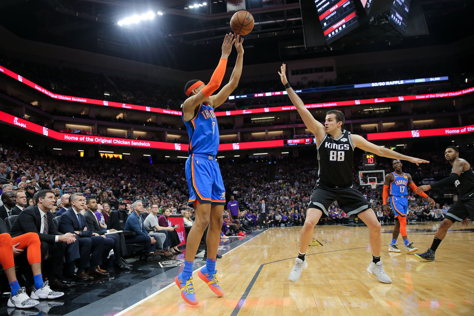 Photo - Jan 29, 2020; Sacramento, California, USA; Oklahoma City Thunder forward Darius Bazley (7) shoots the ball over Sacramento Kings forward Nemanja Bjelica (88) during the second quarter at Golden 1 Center. Mandatory Credit: Sergio Estrada-USA TODAY Sports