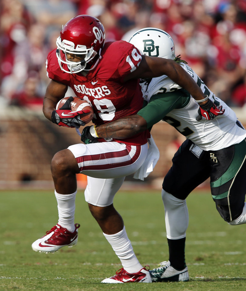 Photo - Oklahoma Sooner Justin Brown (19) runs during the college football game between the University of Oklahoma Sooners (OU) and the Baylor University Bears (BU) at Gaylord Family-Oklahoma Memorial Stadium in Norman, Okla., Saturday, Nov. 10, 2012.  Photo by Steve Sisney, The Oklahoman