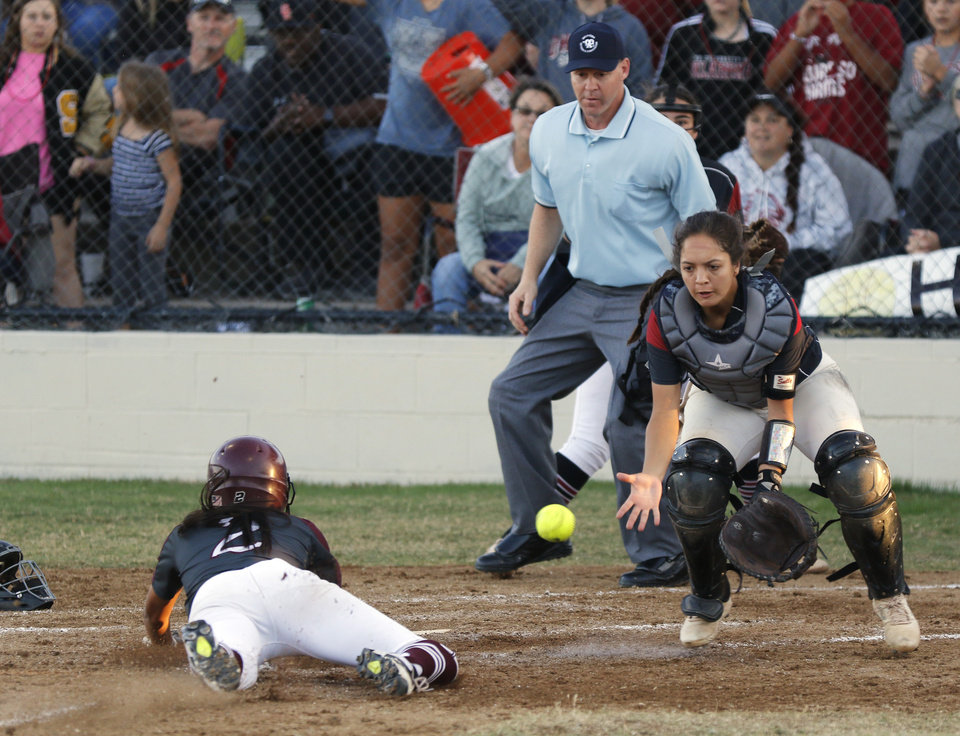 Photo - EHS #2 Caylor Cole slides home safely against OHS #12 Aaliyah Ahmed during the 6A Fast Pitch Championship game between Edmond Memorial and Owasso at the Ball Fields at Firelake in Shawnee, Saturday, October 19, 2019. [Doug Hoke/The Oklahoman]
