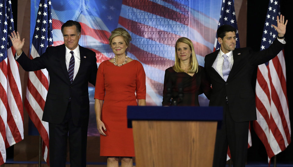 Republican presidential candidate and former Massachusetts Gov. Mitt Romney, his wife Ann Romney, left and Republican vice presidential candidate, Rep. Paul Ryan, R-Wis., and his wife Janna wave to supporters on stage during Romney\'s election night rally, Wednesday, Nov. 7, 2012, in Boston. (AP Photo/David Goldman)