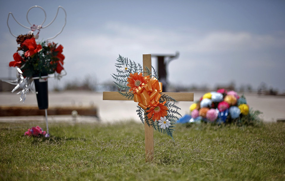 A cross along with other items have been placed as a memorial to the people killed by the May 20th tornado near the former location of 7-Eleven at the corner of SW 4th St and Telephone Road. Megan Futrell and her four-month-old son Case were two of the victims that were killed when the tornado hit the location. CHRIS LANDSBERGER - CHRIS LANDSBERGER