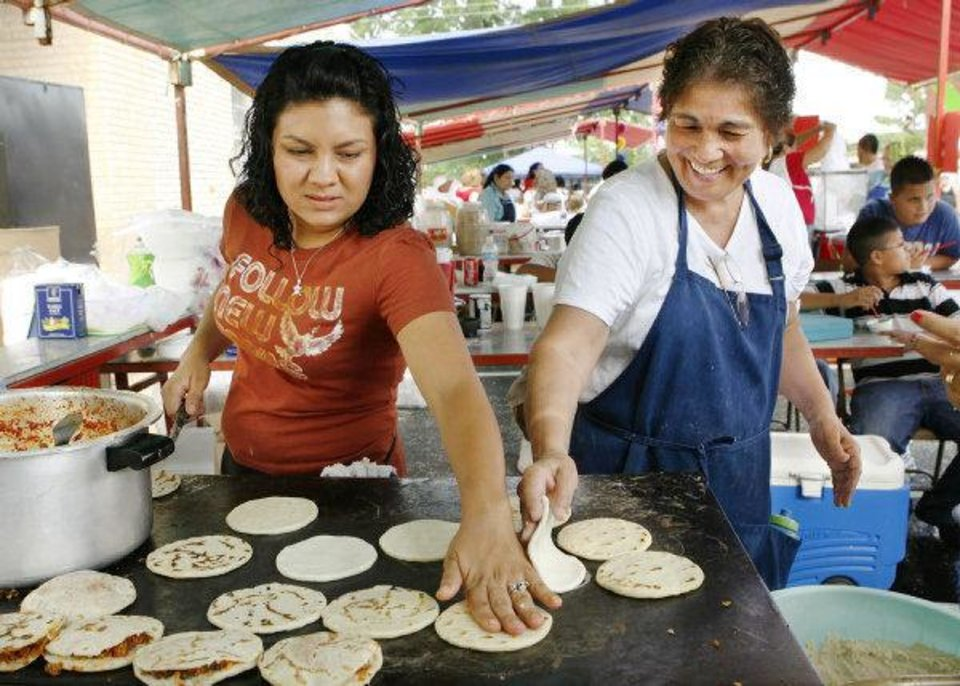Photo - Claudia Rodriguez and Chila Garcia fry the shells for gorditas at their booth at the annual Little Flower Festival (Carnival) at Little Flower Catholic Church, 1125 S Walker, in Oklahoma City. on Sunday, June 29, 2008.  BY JIM BECKEL, THE OKLAHOMAN ORG XMIT: KOD
