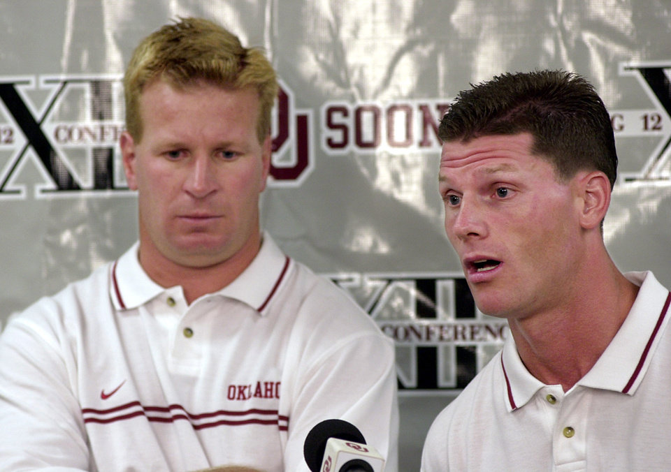 OU Football Media Day. Oklahoma assistant coach Mike Stoops (left)  and Brent Venables (right) address the media Friday morning at OU media day. Staff Photo by Ty Russell.