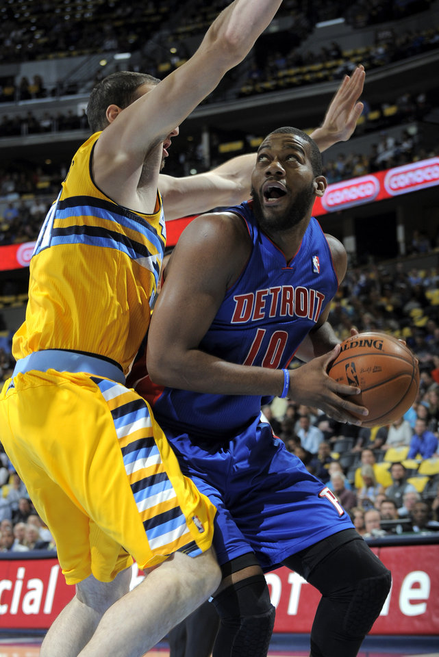 Photo -   Detroit Pistons center Greg Monroe (10) looks to shoot over Denver Nuggets center Kosta Koufos (41) during the first quarter of an NBA basketball game, Tuesday, Nov. 6, 2012, in Denver. (AP Photo/Jack Dempsey)