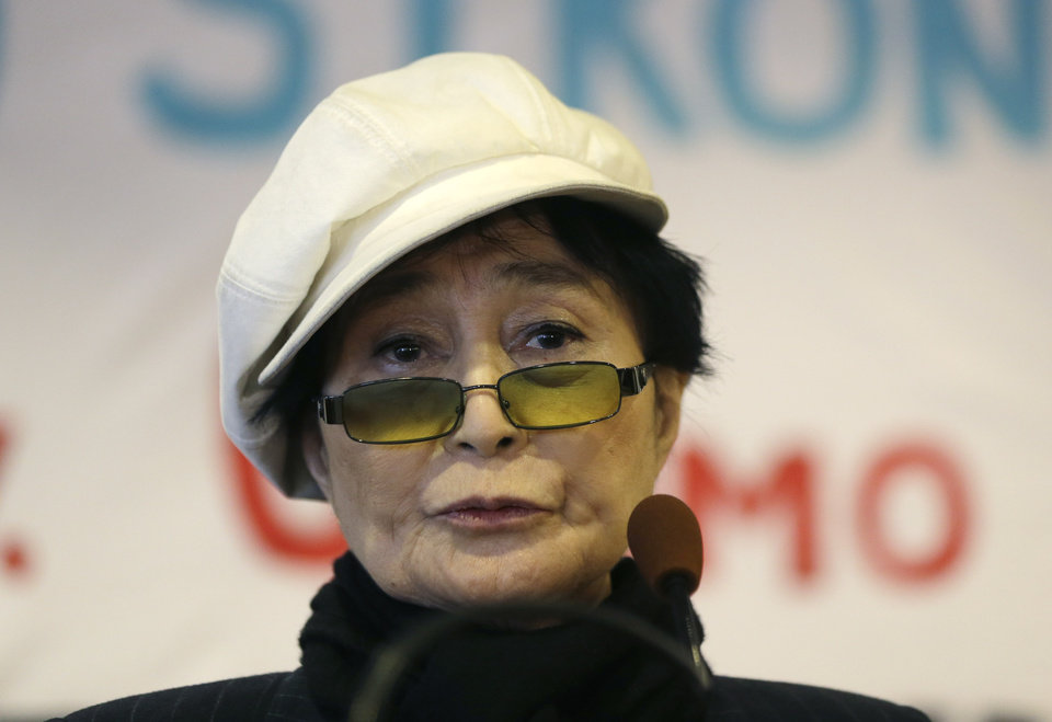 "Yoko Ono speaks during a news conference opposing hydraulic fracturing on Friday, Jan. 11, 2013, in Albany, N.Y. Environmental, health and community groups opposed to shale gas drilling and hydraulic fracturing, or ""fracking,"" say they collected more than 200,000 comments during an intense 30-day effort featuring online coaching and comment-writing workshops at churches, community centers, food co-ops, coffee shops and holiday house parties from New York City to Buffalo. (AP Photo/Mike Groll)"