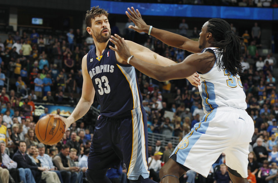Photo - Memphis Grizzlies center Marc Gasol, left, of Spain, looks to pass the ball under pressure from Denver Nuggets forward Kenneth Faried in the first quarter of an NBA basketball game in Denver, Friday, March 15, 2013. (AP Photo/David Zalubowski)
