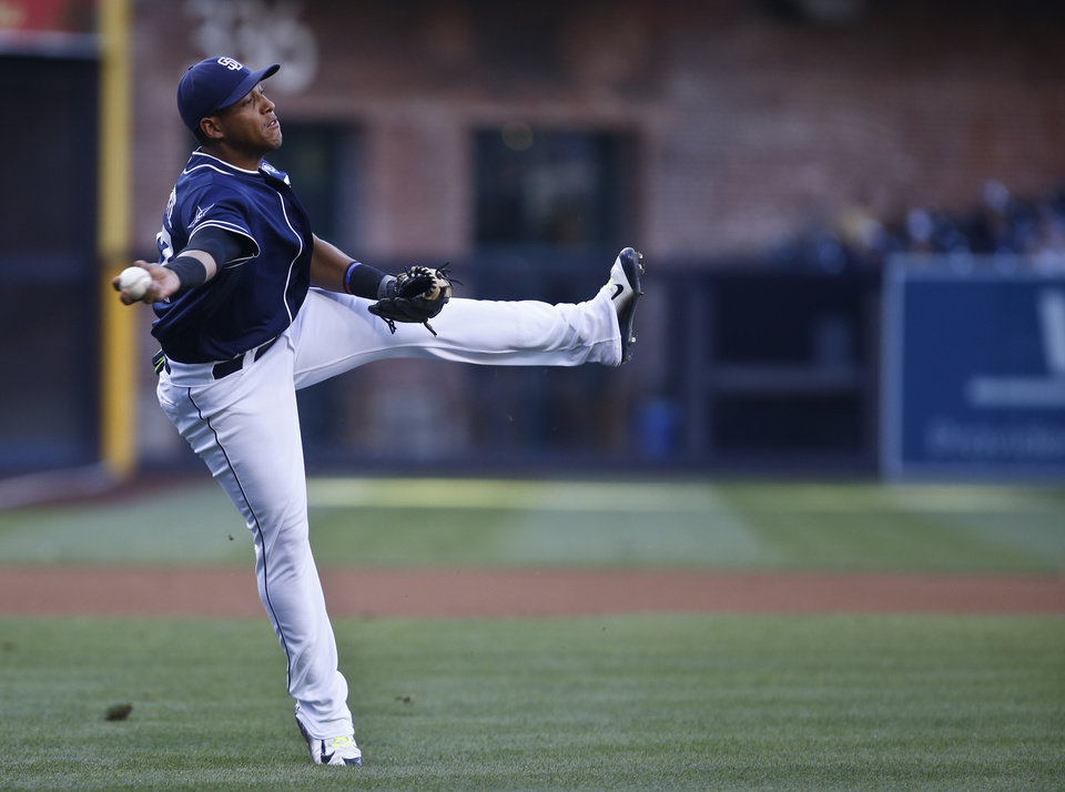 Photo - San Diego Padres third baseman Yangervis Solarte makes the off balance throw to get Los Angeles Dodgers' Dee Gordon at first after Gordon bunted in the first inning of a baseball game Saturday, Aug. 30, 2014, in San Diego.  (AP Photo/Lenny Ignelzi)