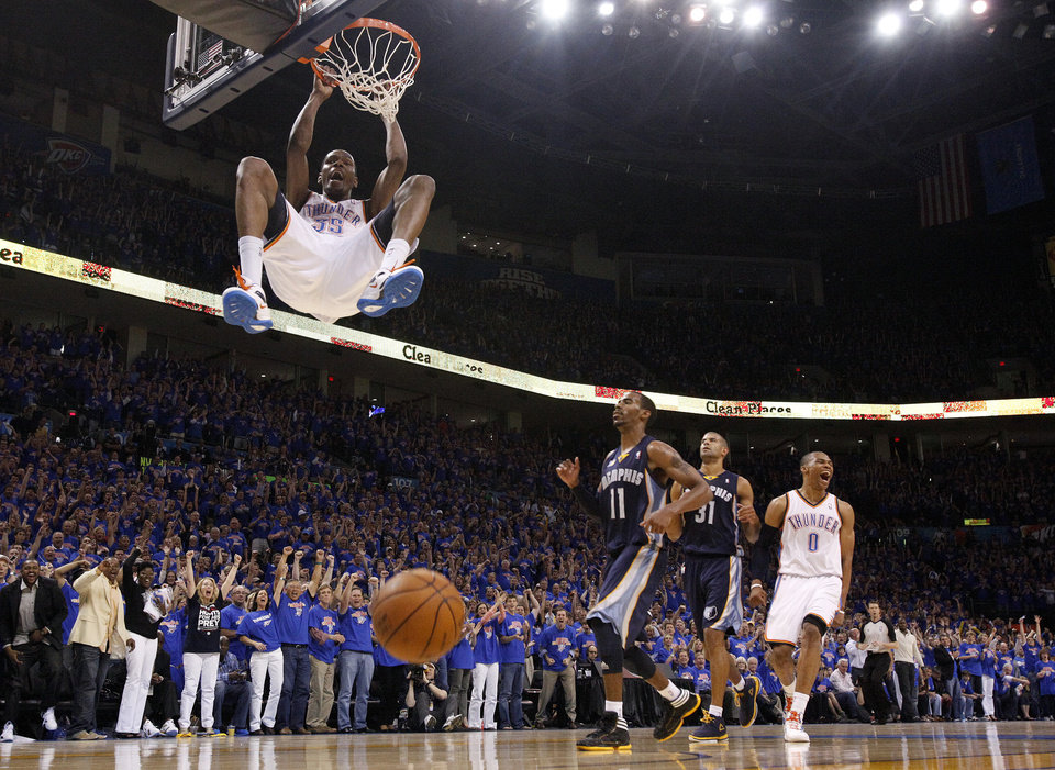 Photo - Oklahoma City's Kevin Durant (35) dunks the ball as Russell Westbrook (0) celebrates near Mike Conley (11) and Shane Battier (31) of Memphis in the fourth quarter during game 7 of the NBA basketball Western Conference semifinals between the Memphis Grizzlies and the Oklahoma City Thunder at the OKC Arena in Oklahoma City, Sunday, May 15, 2011. Photo by Sarah Phipps, The Oklahoman