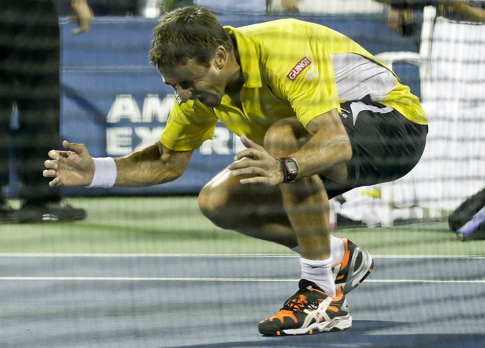 Photo - Tommy Robredo, of Spain, reacts after winning a fourth round match against Roger Federer, of Switzerland, during the 2013 U.S. Open tennis tournament, Monday, Sept. 2, 2013, in New York. (AP Photo/Darron Cummings)