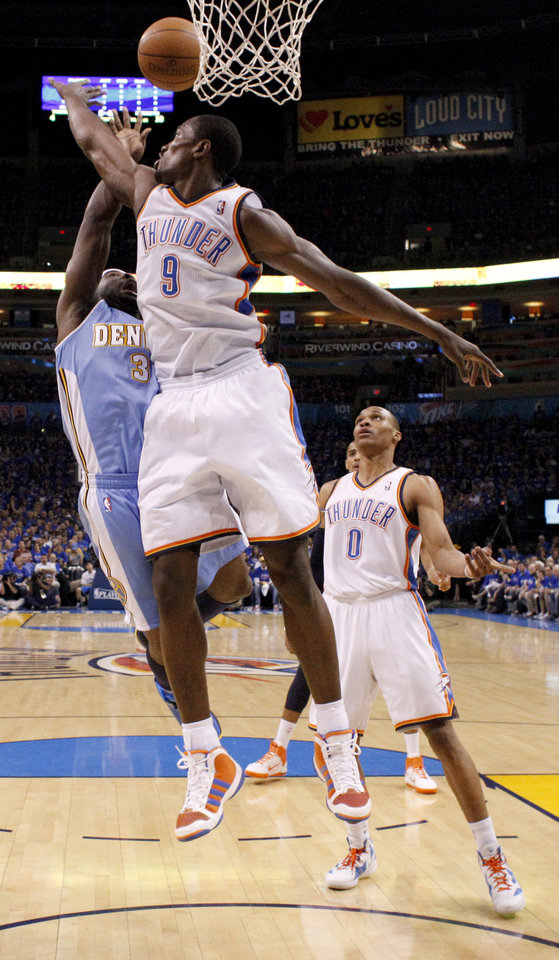 Photo - Oklahoma City's Serge Ibaka (9) defends Denver's Ty Lawson (3) during the NBA basketball game between the Denver Nuggets and the Oklahoma City Thunder in the first round of the NBA playoffs at the Oklahoma City Arena, Sunday, April 17, 2011. Photo by Bryan Terry, The Oklahoman