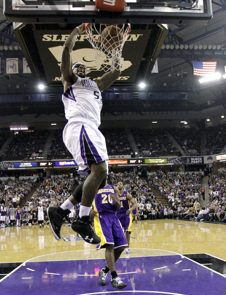 Photo -   Sacramento Kings forward James Johnson, let, dunks over Los Angeles Lakers guard Jodie Meeks, right, during the second half of an NBA basketball game in Sacramento, Calif., Wednesday, Nov. 21, 2012. The Kings won 113-97. (AP Photo/Rich Pedroncelli)