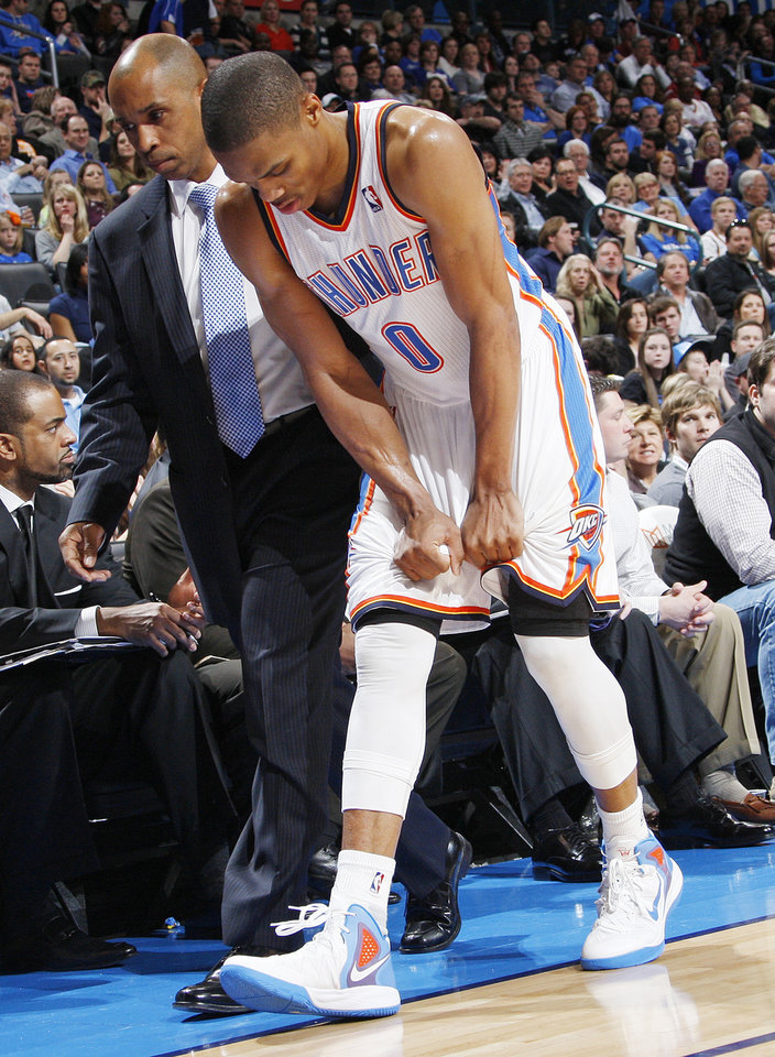 Oklahoma City's Russell Westbrook (0) leaves the court after being hurt on a play in the third quarter during the NBA basketball game between the Oklahoma City Thunder and the Golden State Warriors at the Chesapeake Energy Arena in Oklahoma City, Friday, Feb. 17, 2012. The Thunder won, 110-87. Photo by Nate Billings, The Oklahoman