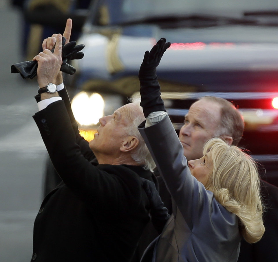 Vice President Joe Biden, left, and his wife, Jill, wave to people as they walk down Pennsylvania Avenue en route to the White House, Monday, Jan. 21, 2013, in Washington. Thousands marched during the 57th Presidential Inauguration parade after the ceremonial swearing-in of President Barack Obama. (AP Photo/Steve Helber) ORG XMIT: DCMS124
