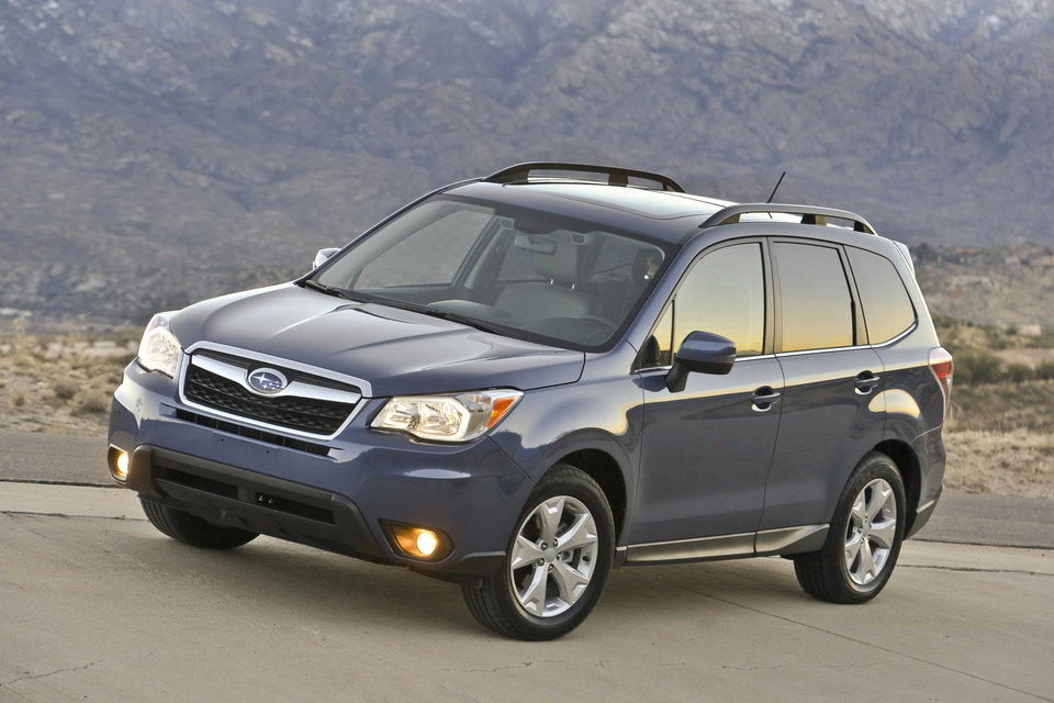 Photo - This photo provided by Subaru shows the 2014 Subaru Forester.  The Subaru Forester, well known as a durable and eminently functional compact sport utility vehicle, adds more power, more room, more safety features and a retuned suspension for 2014. The new, fourth-generation Forester also has higher fuel economy ratings than its predecessor, 24 miles per gallon in city driving and 32 mpg on the highway with base, 170-horsepower, four-cylinder engine and fuel-efficient continuously variable transmission (CVT).  (AP Photo/Subaru)