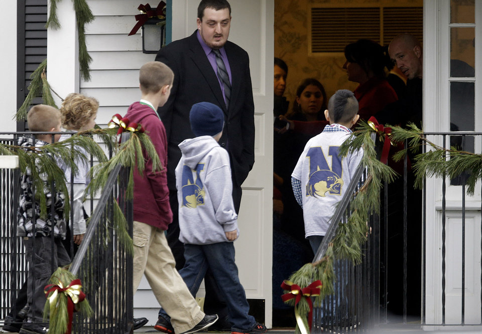 Photo - Mourners arrive for the funeral service of Sandy Hook Elementary School shooting victim, Jack Pinto, 6, Monday, Dec. 17, 2012, in Newtown, Conn. Pinto was killed when a gunman walked into Sandy Hook Elementary School in Newtown Friday and opened fire, killing 26 people, including 20 children.(AP Photo/David Goldman) ORG XMIT: CTDG112