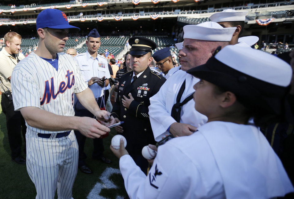 Photo - National League's David Wright, of the New York Mets, signs autographs for members of the military before the MLB All-Star baseball game, on Tuesday, July 16, 2013, in New York. (AP Photo/Matt Slocum)