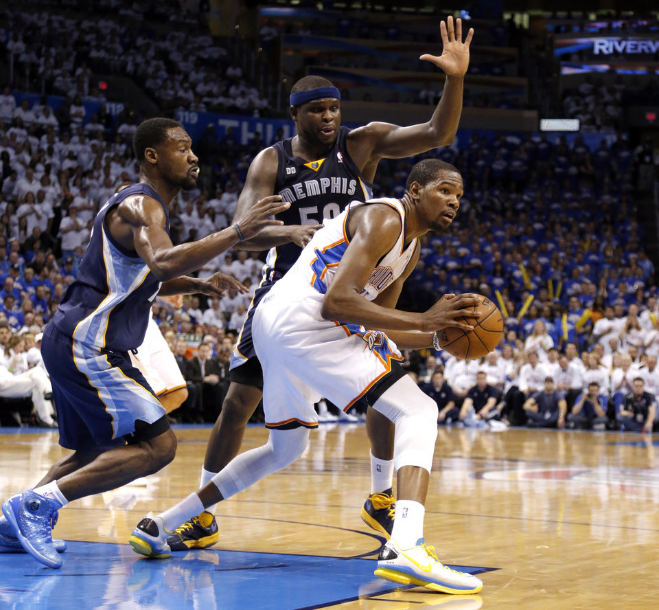 Oklahoma City\'s Kevin Durant (35) looks to pass the ball as he is defended by Memphis\' Tony Allen (9) and Zach Randolph (50) in Game 2 in the second round of the NBA playoffs between the Oklahoma City Thunder and the Memphis Grizzlies at Chesapeake Energy Arena in Oklahoma City, Tuesday, May 7, 2013. Memphis won 99-93. Photo by Sarah Phipps, The Oklahoman