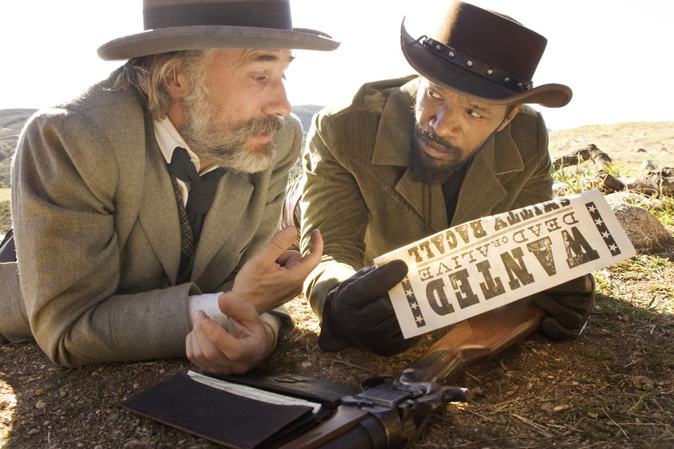 "FILE - This undated publicity image released by The Weinstein Company shows, from left, Christoph Waltz as Schultz and Jamie Foxx as Django in ""Django Unchained,"" directed by Quentin Tarantino. In Los Angeles, the Weinstein Co. canceled Tuesday, Dec. 18, 2012, planned premiere of the violent movie ""Django Unchained.""  (AP Photo/The Weinstein Company, Andrew Cooper, SMPSP, File)"