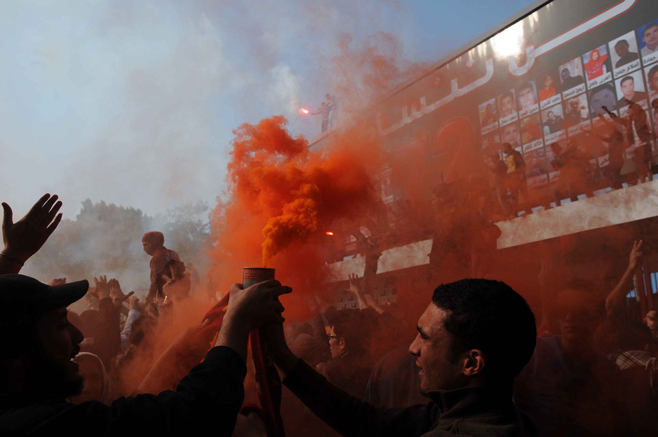 UPDATES DEATH TOLL - Egyptian soccer fans of Al-Ahly club celebrate a court verdict that returned 21 death penalties in last years soccer violence, inside the club premises in Cairo, Egypt, Saturday, Jan. 26, 2013. Egyptian security officials say that 38 people have died in the Mediterranean city of Port Said after a judge sentenced 21 people to death in connection to one of the world's deadliest incidents of soccer violence. (AP Photo/Nameer Galal)