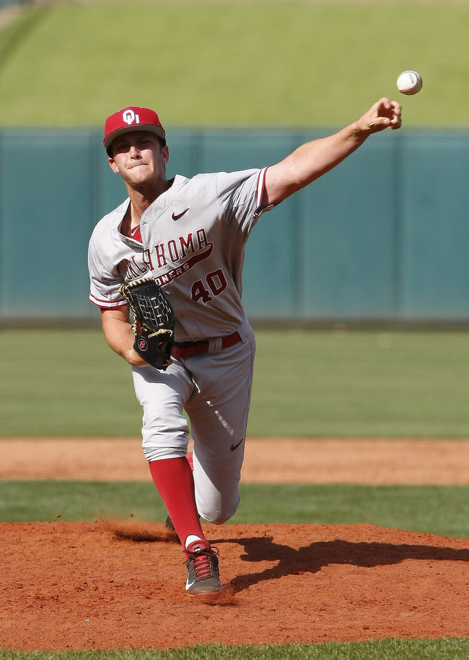Photo - Oklahoma's Jeffery Curran pitches in the first inning of a first-round game against Oklahoma State in the Big 12 conference NCAA college baseball tournament in Oklahoma City, Wednesday, May 21, 2014. (AP Photo/Alonzo Adams)