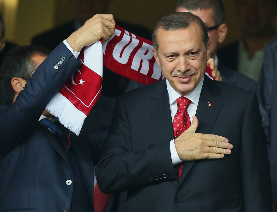 Photo -   Turkish Prime Minister Recep Tayyip Erdogan gestures before Turkey's World Cup qualifying soccer match against Romania at Sukru Saracoglu Stadium in Istanbul, Turkey, Friday, Oct. 12, 2012. (AP Photo)