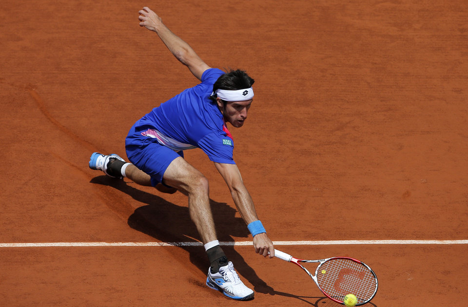 Photo - Argentina's Leonardo Mayer returns the ball to Spain's Rafael Nadal during their third round match of  the French Open tennis tournament at the Roland Garros stadium, in Paris, France, Saturday, May 31, 2014. (AP Photo/Michel Spingler)