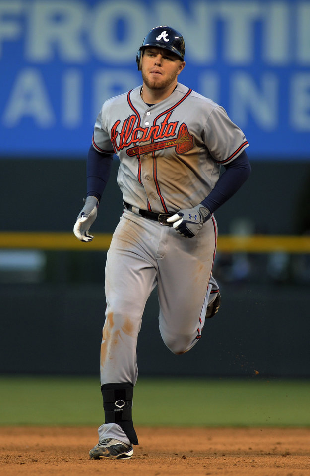 Photo -   Atlanta Braves' Freddie Freeman rounds the bases after hitting a two run home run off Colorado Rockies starting pitcher Guillermo Moscoso during the third inning of a baseball game, Friday, May 4, 2012, in Denver. (AP Photo/Jack Dempsey)