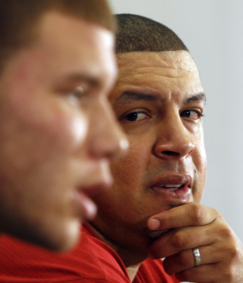 Sooner head basketball coach Jeff Capel listens as University of Oklahoma basketball star Blake Griffin announces he will leave the Sooner team for the NBA professional draft in Norman, Okla. on Tuesday, April 7, 2009. Photo by Steve Sisney, The Oklahoman