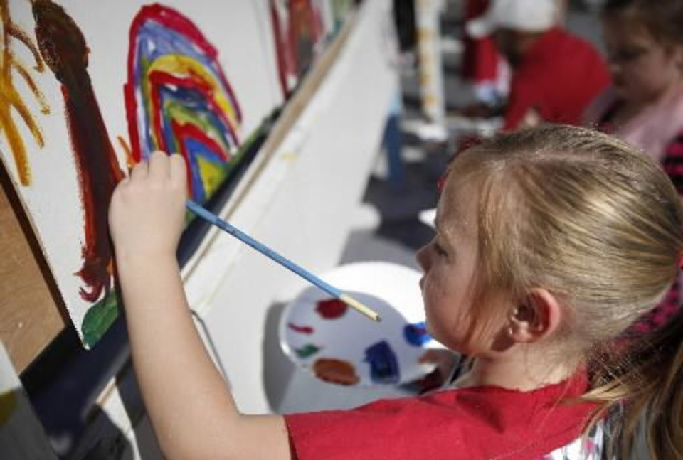 Photo -  Payton Wolfe, 5, paints a rainbow during the 2011 Plaza District Festival in Oklahoma City. Photo by Sarah Phipps, The Oklahoman Archives