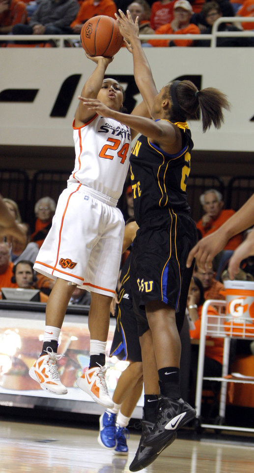 Photo - Oklahoma State's Carissa Crutchfield (24) shoots over Coppin State's Crystal Whittington (23) during the women's college game between Oklahoma State University and Coppin State at Gallagher-Iba Arena in Stillwater, Okla.,  Saturday, Nov. 26, 2011.  Photo by Sarah Phipps, The Oklahoman