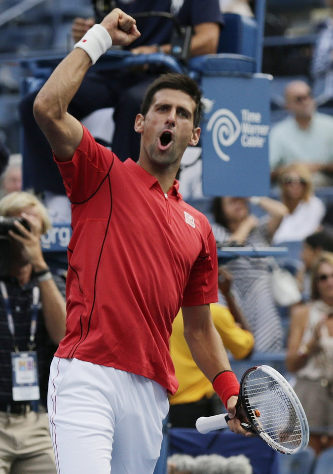 Photo - Novak Djokovic, of Serbia, after defeating Marcel Granollers, of Spain, in straight sets during the fourth round of the 2013 U.S. Open tennis tournament, Tuesday, Sept. 3, 2013, in New York. (AP Photo/Charles Krupa)