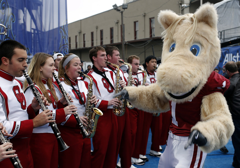 Photo - Boomer lead the Oklahoma marching band at a pep rally in the French Quarter, Wednesday, Jan. 1, 2014 in New Orleans. Photo by Sarah Phipps, The Oklahoman