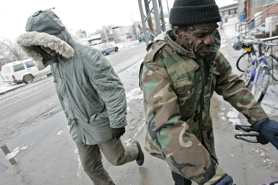 WINTER / COLD / WEATHER / ICE STORM: Griffin James (right) and another unidentified man (left) head toward the Shartel entrance to the City Rescue Mission in Oklahoma City on Monday, Dec. 10, 2007. By John Clanton, The Oklahoman ORG XMIT: KOD