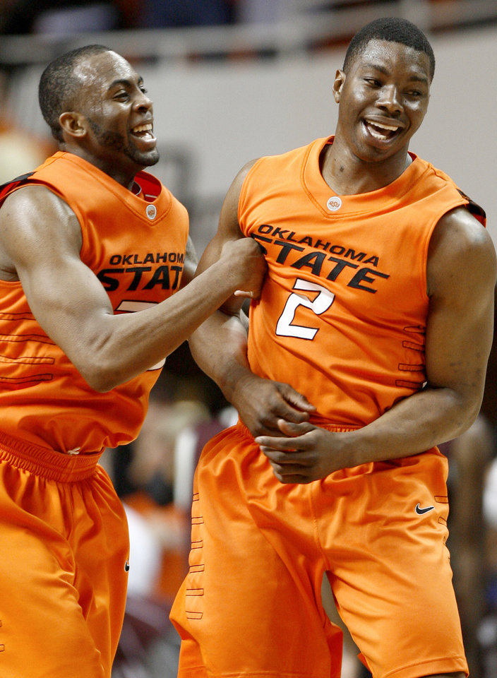 Photo - OSU's James Anderson, left, and Obi Muonelo celebrate during an NCAA college basketball game between the Oklahoma State University and Texas A&M at Gallagher-Iba Arena in Stillwater, Okla., Wednesday, January 27, 2010. Photo by Bryan Terry, The Oklahoman