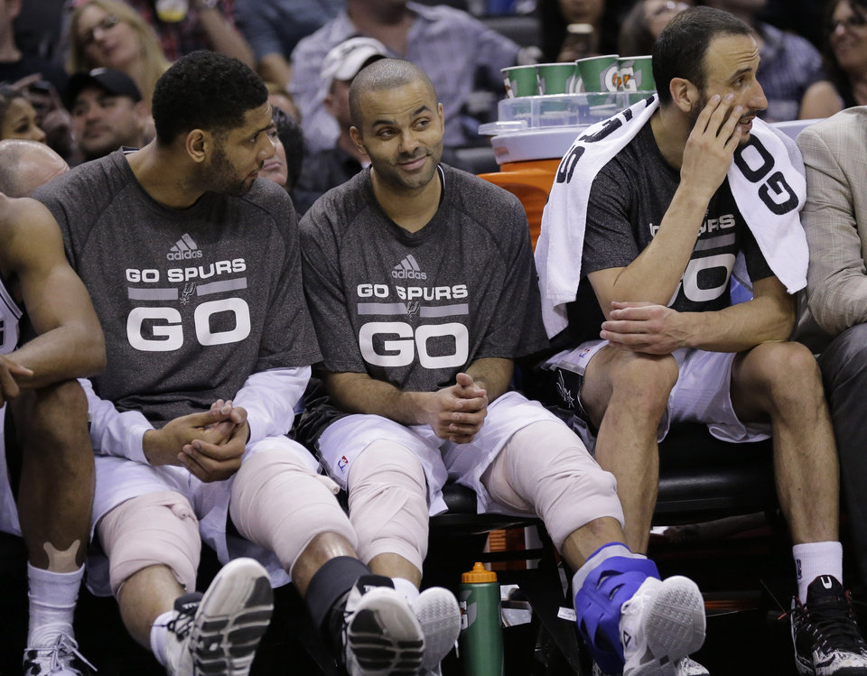 Photo -                    The Spurs trio of, from left, Tim Duncan, Tony Parker and Manu Ginobili has averaged 53.5 points, 14.5 rebounds and 14.0 assists while shooting 54 percent from the field during the first two games of the Western Conference Finals.                     AP photo