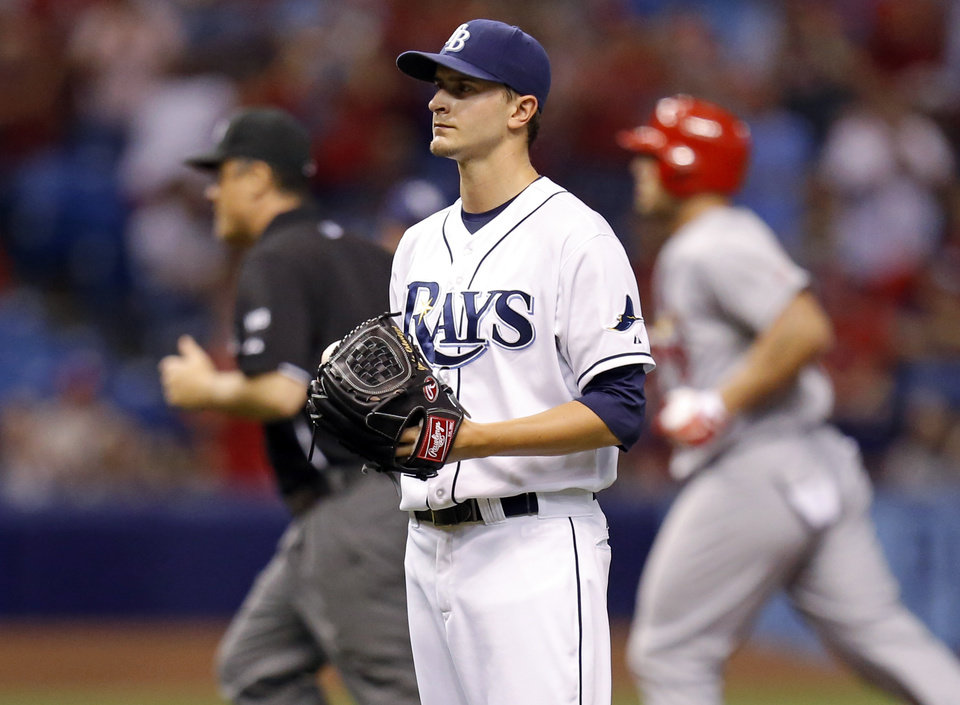 Photo - Tampa Bay Rays starting pitcher Jake Odorizzi reacts after giving up a solo home run to St. Louis Cardinals' Matt Holliday during the sixth inning of a baseball game Tuesday, June 10, 2014, in St. Petersburg, Fla. (AP Photo/Mike Carlson)