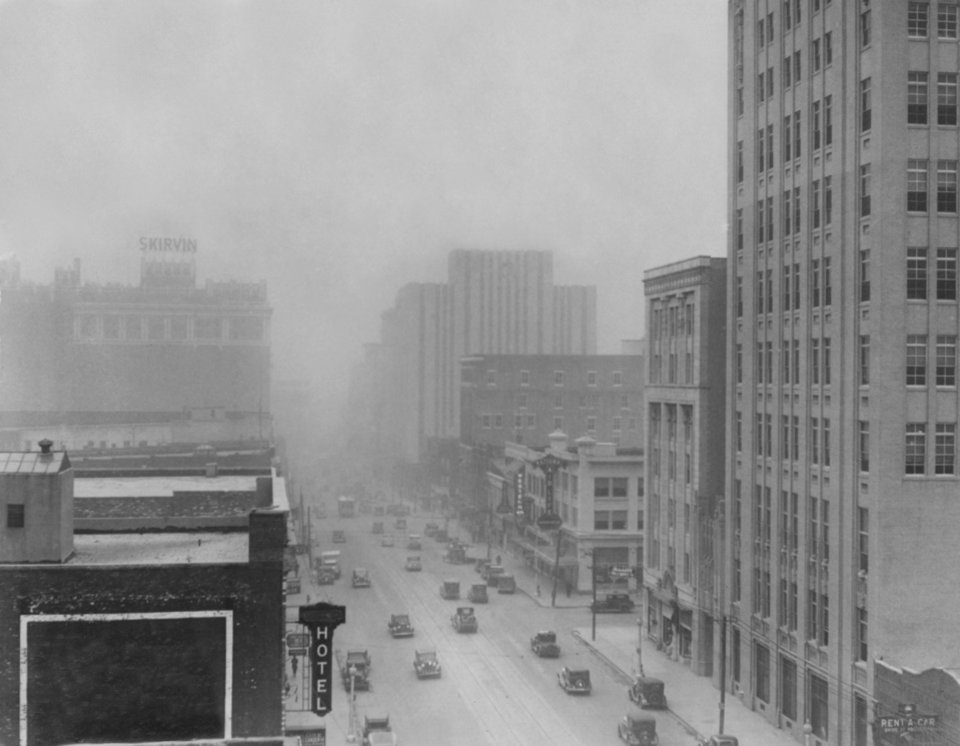 Photo - A dust storm blows through downtown Oklahoma City in 1935.  THE OKLAHOMAN ARCHIVES  UNKNOWN