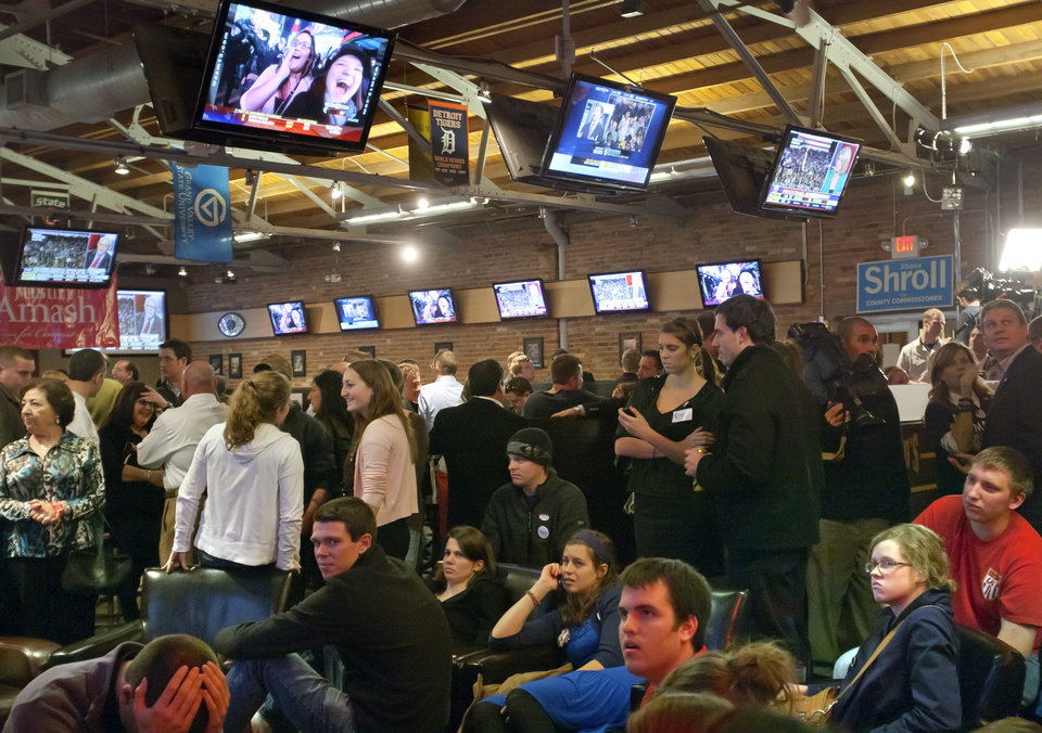 Photo -   Republican supporters react to the re-election of President Barack Obama as they watch television broadcasts at Peppino's in downtown Grand Rapids, Mich., Tuesday, Nov. 6, 2012. (AP Photo/The Grand Rapids Press, Cory Morse) ALL LOCAL TV OUT; LOCAL TV INTERNET OUT