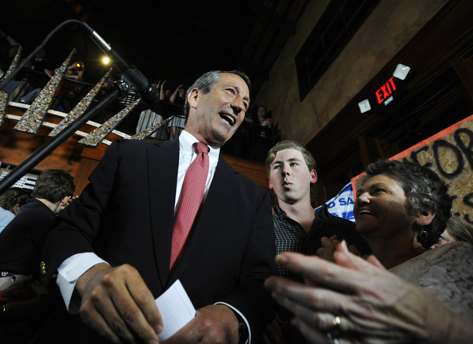 Photo - Former South Carolina Gov. Mark Sanford, left, gives his victory speech after winning back his old congressional seat in the state's 1st District on Tuesday, May 7, 2013, in Mt. Pleasant, S.C. (AP Photo/Rainier Ehrhardt)