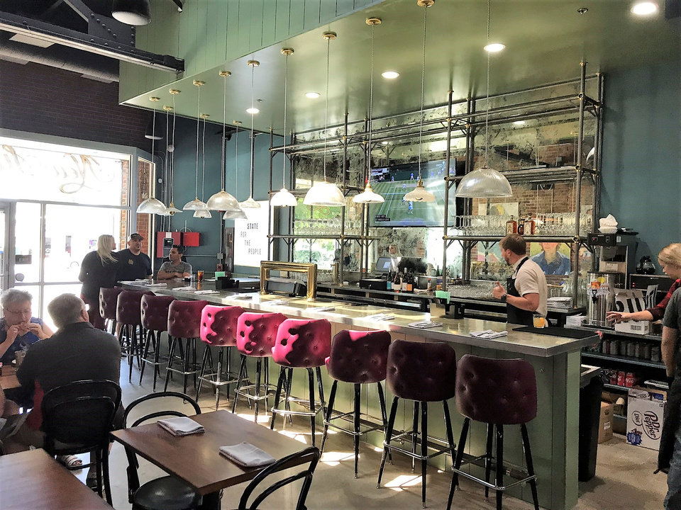 Photo - The bar at New State Burgers, opening this week in Oklahoma City's Plaza District. [Dave Cathey/The Oklahoman]