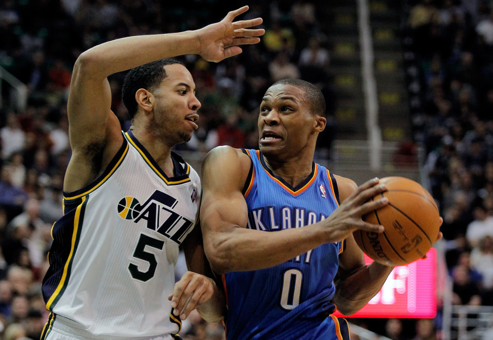 Oklahoma City Thunder guard Russell Westbrook (0) drives against Utah Jazz guard Devin Harris (5) during the first half of their NBA basketball game in Salt Lake City, Friday, Feb. 10, 2012. (AP Photo/Steve C. Wilson) ORG XMIT: UTSW103